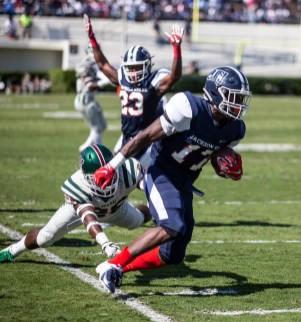 Jackson State's Jordan Johnson runs towards the end zone while getting around a Mississippi Valley State University defender during JSU's homecoming game Saturday, October 13, 2018.