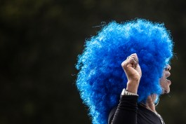 """A parade participant wears a blue wig celebrating Jackson State University's homecoming theme """"Thee Revolution"""" during JSU's homecoming parade near JSU's campus Saturday, October 13, 2018."""