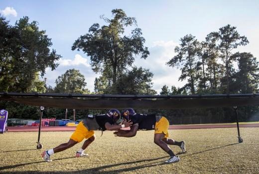 Hattiesburg High School football players perform drills during practice Wednesday, October 11, 2018.