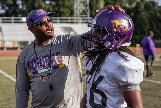 Hattiesburg High football coach Tony Vance gives a talk to wide receiver Nakirri Gray during practice Wednesday, October 11, 2018.