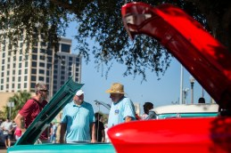 David Williams, James Young and Tom Allen take a look at a 1958 Edsel during the Biloxi Block Party in the 22nd Annual Cruisin' The Coast event on the Gulf Coast Wednesday, October 3, 2018.