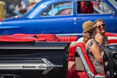 Trisha Lanier, left, and Charlotte Hart share a laugh as they sit inside a 1960 Chevrolet Impala during the Biloxi Block Party in the 22nd Annual Cruisin' The Coast event on the Gulf Coast Wednesday, October 3, 2018.