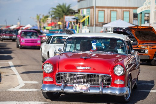 Classic car enthusiasts showoff their cars during the feature car appearance in the 22nd Annual Cruisin' The Coast event on the Gulf Coast Thursday, October 4, 2018.