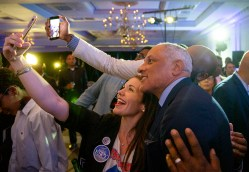 Mike Espy takes photos with supporters during his watch party at the Hilton Jackson on County Line Road Tuesday, November 6, 2018. Espy will be in a run-off with Republican interim Sen. Cindy Hyde-Smith.