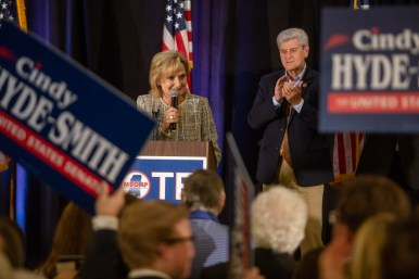 Governor Phil Bryant, right, stands behind Republican interim Sen. Cindy Hyde-Smith as she speaks to supporters during her watch party at the Westin Jackson Tuesday, November 6, 2018.