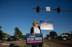 U.S. Sen. Cindy Hyde-Smith, R-Miss., waves to drivers as she holds a campaign sign at the intersection of Ridgewood Road and Lakeland Drive Tuesday, November 6, 2018.