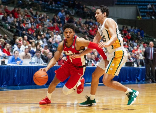 Ole Miss' Breein Tyree (4) tries to get past defenders during their game against Southeastern Louisiana at the Mississippi Coliseum Wednesday, December 12, 2018.