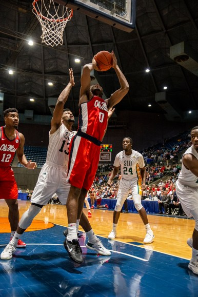 Ole Miss' Blake Hinson (0) goes up for a shot while being guarded by Southeastern Louisiana's Moses Greenwood during their game at the Mississippi Coliseum Wednesday, December 12, 2018.