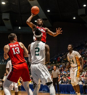 Ole Miss' Blake Hinson (0) goes up for a shot while being guarded by Southeastern Louisiana defenders during their game at the Mississippi Coliseum Wednesday, December 12, 2018.