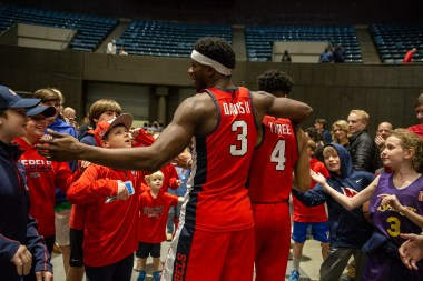 Ole Miss' Terence Davis (3) and Breein Tryree (4) are congratulated by fans after their win against Southeastern Louisiana at the Mississippi Coliseum Wednesday, December 12, 2018.