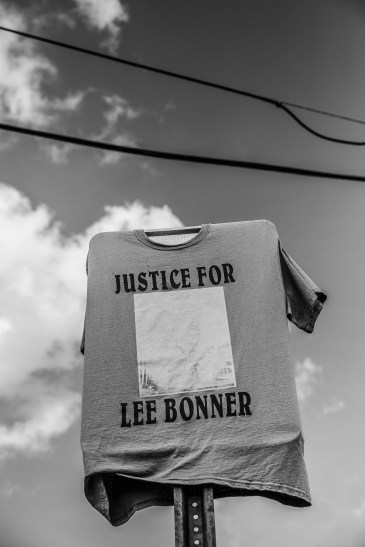 A faded shirt in honor of Lee Edward Bonner, 37, covers a street sign in the 1300 block of Deer Park Street in Jackson. Bonner was shot and killed by a Jackson police officer February 26, 2018.