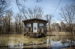 Flood water surrounds a home in Tchula, Miss. Saturday, March 23, 2019.