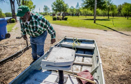 Anderson Jones Sr., 59, prepares his boat as he gets ready to travel across flood water to get to his home his in Fitler, Miss., Monday, April 15, 2019.