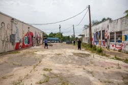 Artists create paint murals on the Center for Community Production building in downtown Jackson Wednesday, April 17, 2019.