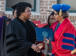 Stacey Abrams, left, receives an honorary degree during Tougaloo College's Sesquicentennial Commencement Exercises at Tougaloo's campus Sunday, May 5, 2019.