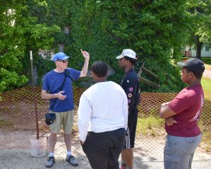 Michael Scanlan talks to his students about Bryants Grocery and Meat Market on May 17