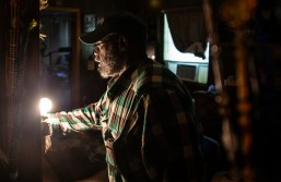 Anderson Jones Sr. turns on a light in his home after traveling through flood water in Fitler, Miss., Monday, April 15, 2019. Jones' journey is a little less than a mile.