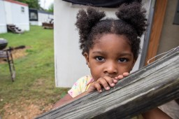 Two-year-old Rihanna Barret is photographed on the steps on her grandmother's home in Tchula, Miss. Thursday, May 9, 2019.