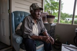 Geneva Williams sits on her porch in Tchula, Miss., Thursday, May 9, 2019. Residents in the Tchula, one of the poorest cities in the state, have been affected by the recent flooding in the Delta.