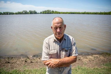 Billy Whitten stands in front of his farmland in Valley Park. Over a 1,000 acres of his land are submerged in flood water.