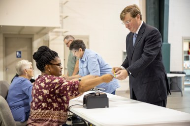 GOP gubernatorial candidate Tate Reeves prepares to vote at Liberty Baptist Church during the GOP runoff elections.