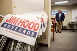 Democratic gubernatorial Jim Hood watches the news as election results come in while at his campaign headquarters Tuesday, August 27, 2019.