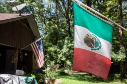 An American flag and a Mexican flag hang on neighboring homes in Morton.