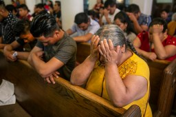 Church members pray in a filled sanctuary during Sacred Heart Catholic Church's Spanish Mass service in Canton, Miss., Sunday, August 11, 2019.