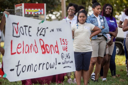 Leland School District students rally with faculty members in support of the district's consideration of a $8.75 million bond referendum that will fix issues in the schools.