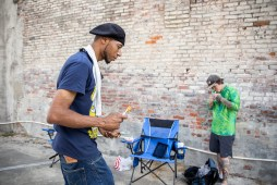 Michael Carter, Chase Reid take a break from painting Chase Reid works on a blues inspired piece during the Paint the Town event in Clarksdale Tuesday, October 1, 2019.