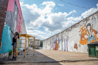 """Erre, of Bogotá, Colombia, works on a piece entitled """"No Boarders"""" during the Paint the Town event in Clarksdale Tuesday, October 1, 2019."""