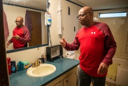 U.S. Army veteran Anthony Burkett points out the severe damage inside of his trailer in Seminary, Miss., Wednesday, October 30, 2019.