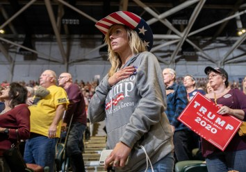 Melanie Ramey honors the Pledge of Allegiance during the Trump rally at BancorpSouth Arena in Tupelo, Miss., Friday, November 1, 2019.