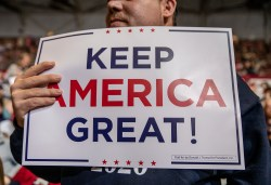 """A supporter holds a """"Keep America Great!"""" sign during the Trump rally at BancorpSouth Arena in Tupelo, Miss., Friday, November 1, 2019."""