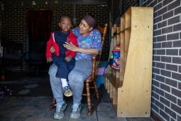 Zelma Davenport holds 2-year-old Zavion Mosley inside of her home, which is also a daycare center that she manages, in Edwards, Miss., Thursday, December 19, 2019. During Monday's tornado, Davenport protected the children in her daycare program by shielding them in the bathtub as the tornado passed. She walked away with minor cuts on her leg. None of the children were hurt.