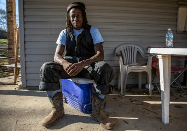 Carlos Jenkins has been helping remove fallen trees from the yards of those who were affected by Monday's tornado in Edwards. Miss.