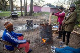Gloria Strickland, from left, Patricia Watts, and Caria Strickland gather around a fire to keep warm on Dabbs Street in Hattiesburg, Miss., Friday, February 21, 2020.