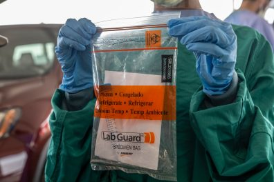 The materials used to collect and contain the specimen from those potentially infected with COVID-19 is shown in a a mock COVID-19 specimen collection at the Mississippi State Fairgrounds in Jackson, Miss., Monday, March 23, 2020.