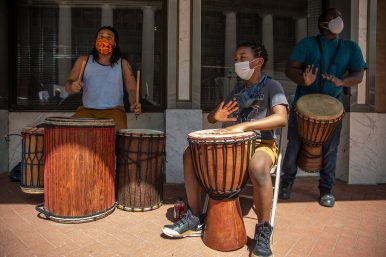 Musicians play drums as protesters march during the Black Lives Matter protest in downtown Jackson, Miss., Saturday, June 6, 2020.