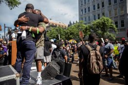 Members of Black Lives Matter embrace after the protest in downtown Jackson, Miss., Saturday, June 6, 2020.