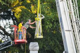 Workers move the Confederate statue located in the Circle at the University of Mississippi to the Confederate Soldiers Cemetery, in Oxford, Miss. on Tuesday, July 14, 2020. (©Bruce Newman)