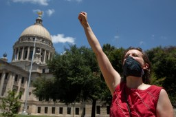 Esther Newell, a Jackson Public School teacher, protests the reopening of Mississippi schools outside of the Capitol in Jackson, Friday, July 17, 2020.