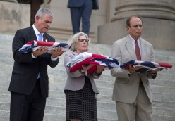 House speaker Philip Gunn, from left, Executive Director of Mississippi Department of Archives and History Kaite Blount, and Mississippi Lt. Gov. Delbert Hosemann prepare to deliver the state flag to the Mississippi Civil Rights Museum Wednesday, July 1, 2020.