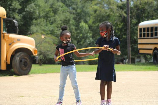 Shykeria and Skylar play inside a hula hoop at the Boys and Girls Club Walker unit in south Jackson after a day of virtual learning on Sept. 14, 2020. The Jackson Public Schools students cannot attend their regular elementary schools, which closed due to the COVID-19 pandemic.