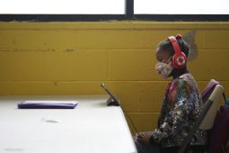 Kenadi, part of the youngest cohort of Boys and Girls Club students, conducts her lessons on an tablet on Sept. 21, 2020.