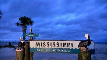 The Mississippi Gulf Coast sign still stands at the intersection of U. S. 90 and Cowan Road in Gulfport Wednesday morning. Although the clouds still look threatening and the wind is stronger, Mississippi Gulf Coast residents are thankful that the area dodged major damage as Hurricane Sally veered toward Mobile and Pensacola.