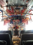A makeshift altar sits at one end of sanctuary school bus.