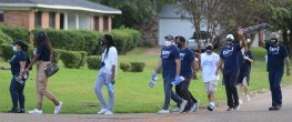 Mike Espy, Democratic U.S. Senate challenger (fourth from left) and campaign workers canvass the Valley North subdivision on Oct. 23 in Jackson.