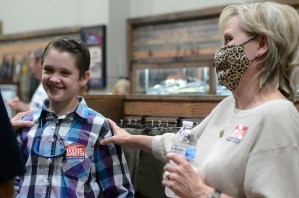 Republican Sen. Cindy Hyde-Smith greets a young supporter at a speaking event hosted by the Madison County Republican Women, the Rankin County Republican Women and the Hinds County Republican Women, Wednesday evening at The Range in Gluckstadt.