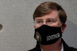 Mississippi Gov. Tate Reeves listens as state emergency management executive director Greg Michel speaks during his news briefing at the Mississippi Emergency Management Headquarters in Pearl, Miss., Monday, Aug. 24, 2020. (AP Photo/Rogelio V. Solis)